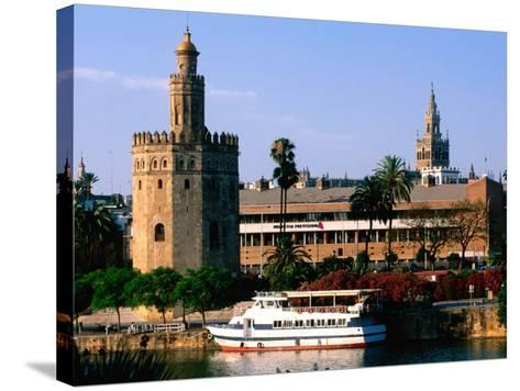 Boat on River in Front of Torre del Oro, Sevilla, Andalucia, Spain-John Elk III-Stretched Canvas Print