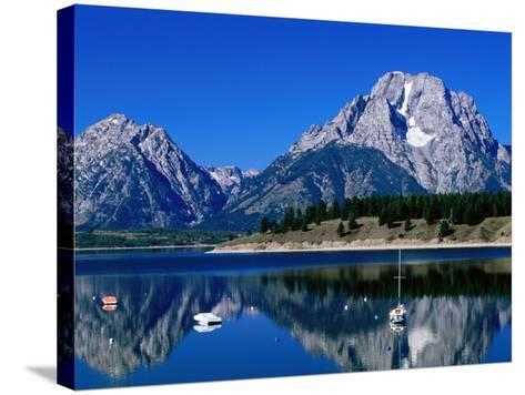 Mount Moran Reflected in Jackson Lake, Grand Teton National Park, Wyoming-Holger Leue-Stretched Canvas Print
