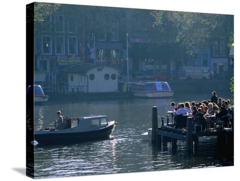 Outdoor Cafe on Canal, Amsterdam, North Holland, Netherlands-Thomas Winz-Stretched Canvas Print