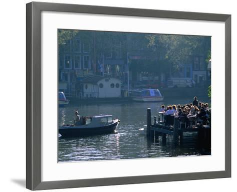 Outdoor Cafe on Canal, Amsterdam, North Holland, Netherlands-Thomas Winz-Framed Art Print