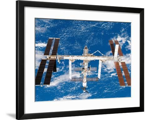 The International Space Station Moves Away from Space Shuttle Endeavour August 19, 2007-Stocktrek Images-Framed Art Print