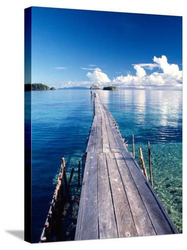 Wooden Jetty Extending off Kadidiri Island, Togian Islands, Sulawesi-Jay Sturdevant-Stretched Canvas Print