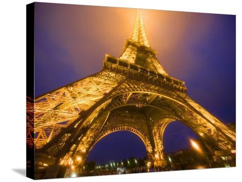 Base of Eiffel Tower at Night, Paris, France-Jim Zuckerman-Stretched Canvas Print