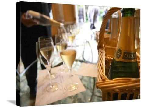Bottle of Deutz Champagne in Wicker Basket at Champagne Deutz, Ay, Vallee De La Marne-Per Karlsson-Stretched Canvas Print