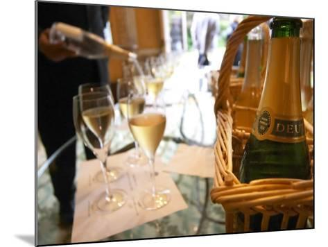 Bottle of Deutz Champagne in Wicker Basket at Champagne Deutz, Ay, Vallee De La Marne-Per Karlsson-Mounted Photographic Print