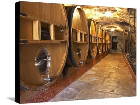 Barrels of Wine Aging in Cellar, Chateau Vannieres, La Cadiere d'Azur-Per Karlsson-Stretched Canvas Print