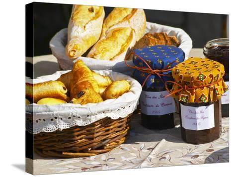 Wicker Basket with Croissants and Breads, Clos Des Iles, Le Brusc, Var, Cote d'Azur, France-Per Karlsson-Stretched Canvas Print