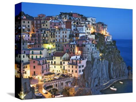 Dusk Falls on a Hillside Town Overlooking the Mediterranean Sea, Manarola, Cinque Terre, Italy-Dennis Flaherty-Stretched Canvas Print