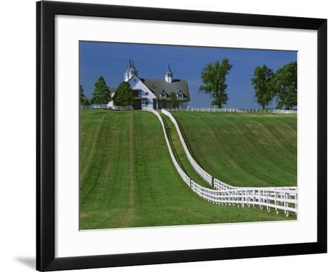Double White Fence Flows from an Elegant Horse Barn, Woodford County, Kentucky, USA-Dennis Flaherty-Framed Art Print