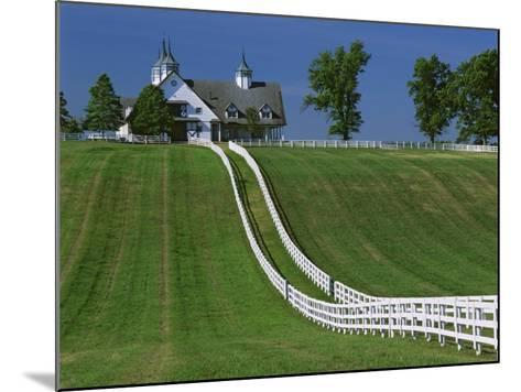 Double White Fence Flows from an Elegant Horse Barn, Woodford County, Kentucky, USA-Dennis Flaherty-Mounted Photographic Print