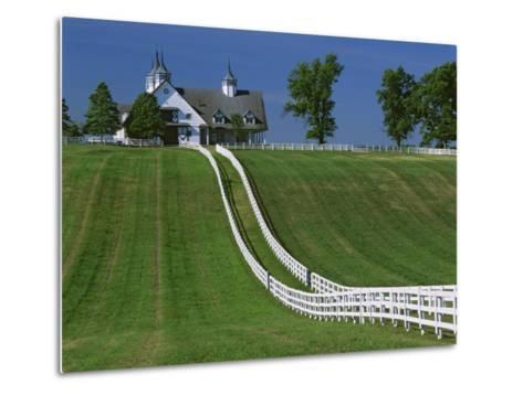 Double White Fence Flows from an Elegant Horse Barn, Woodford County, Kentucky, USA-Dennis Flaherty-Metal Print