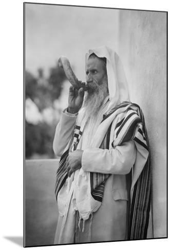 Rabbi Blowing the Shofar--Mounted Photo