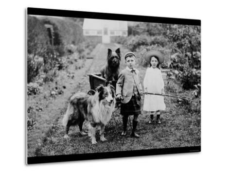 Boy and Girls with Two Dogs and a Wagon--Metal Print