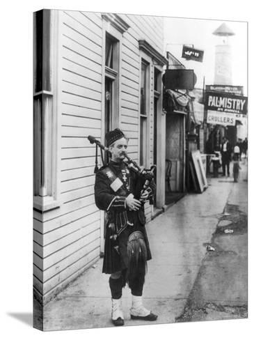 Scottish Bagpiper-Irving Underhill-Stretched Canvas Print