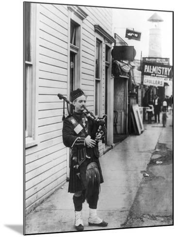 Scottish Bagpiper-Irving Underhill-Mounted Photo