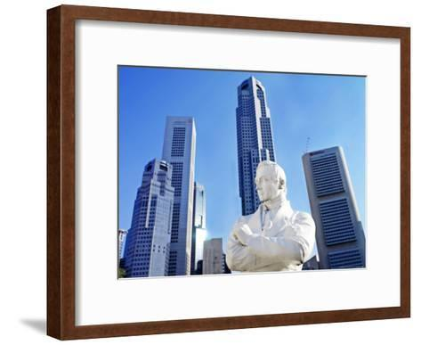 A Statue of Sir Stamford Raffles Against the Cityscape of Singapore-xPacifica-Framed Art Print