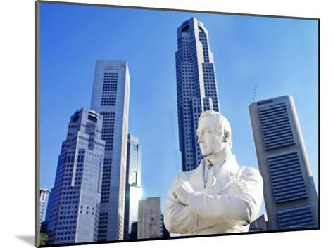 A Statue of Sir Stamford Raffles Against the Cityscape of Singapore-xPacifica-Mounted Photographic Print