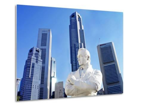 A Statue of Sir Stamford Raffles Against the Cityscape of Singapore-xPacifica-Metal Print