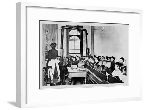 Teacher Instructs Students from Blackboard in Classroom--Framed Art Print