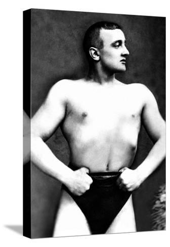 Bodybuilder with Thumbs Tucked in Belt--Stretched Canvas Print