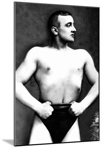 Bodybuilder with Thumbs Tucked in Belt--Mounted Art Print