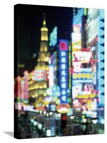 Blurred Neon Lights at Night, Nanjing Dong Lu New Pedestrian Street, Nanjing Road, Shanghai, China-Gavin Hellier-Stretched Canvas Print
