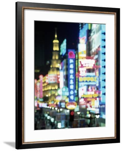 Blurred Neon Lights at Night, Nanjing Dong Lu New Pedestrian Street, Nanjing Road, Shanghai, China-Gavin Hellier-Framed Art Print