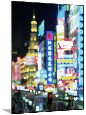 Blurred Neon Lights at Night, Nanjing Dong Lu New Pedestrian Street, Nanjing Road, Shanghai, China-Gavin Hellier-Mounted Photographic Print