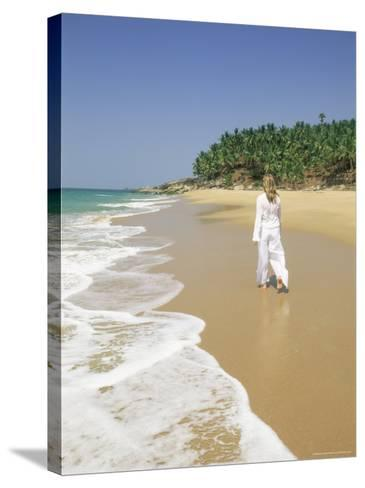 Woman Tourist Walking Along the Beach, Kovalam, Kerala State, India, Asia-Gavin Hellier-Stretched Canvas Print