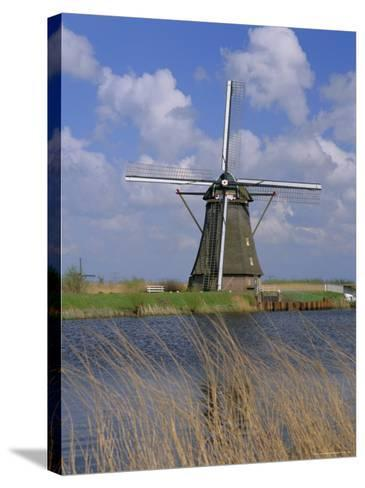 Windmill on the Canal, Kinderdijk, Unesco World Heritage Site, Holland (The Netherlands), Europe-Gavin Hellier-Stretched Canvas Print