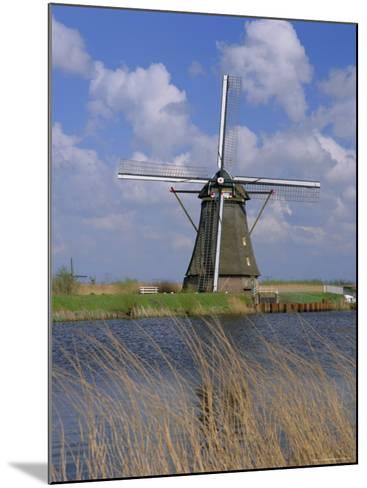 Windmill on the Canal, Kinderdijk, Unesco World Heritage Site, Holland (The Netherlands), Europe-Gavin Hellier-Mounted Photographic Print