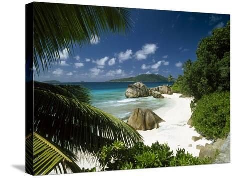 Tropical Beach Scene, Anse Patates, La Digue, Seychelles-Lee Frost-Stretched Canvas Print