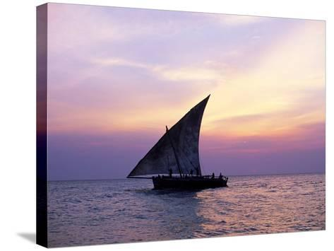 Dhow in Silhouette on the Indian Ocean at Sunset, off Stone Town, Zanzibar, Tanzania, East Africa-Lee Frost-Stretched Canvas Print