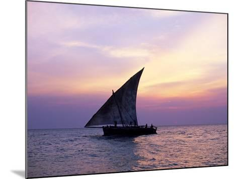 Dhow in Silhouette on the Indian Ocean at Sunset, off Stone Town, Zanzibar, Tanzania, East Africa-Lee Frost-Mounted Photographic Print