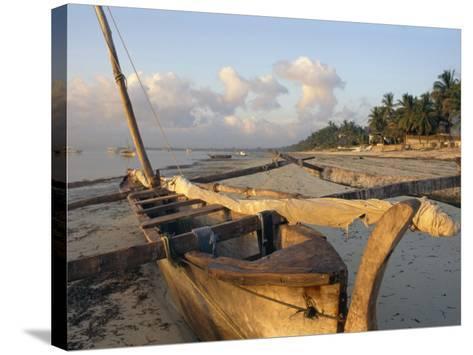 Canoe Pulled up onto Beach at Dusk, Bamburi Beach, Near Mombasa, Kenya, Africa-Charles Bowman-Stretched Canvas Print