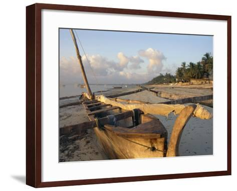 Canoe Pulled up onto Beach at Dusk, Bamburi Beach, Near Mombasa, Kenya, Africa-Charles Bowman-Framed Art Print