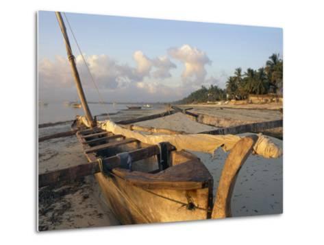 Canoe Pulled up onto Beach at Dusk, Bamburi Beach, Near Mombasa, Kenya, Africa-Charles Bowman-Metal Print