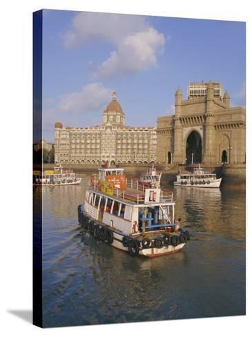 The Gateway to India and the Taj Mahal Hotel, Mumbai (Bombay), India-Charles Bowman-Stretched Canvas Print