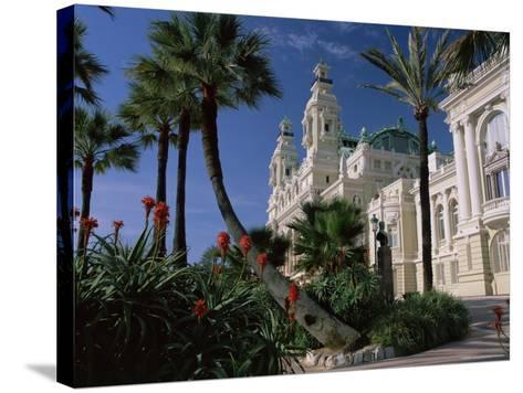 The Casino from the South Terrace, Palms and Flowers in Foreground, Monte Carlo, Monaco, Europe-Ruth Tomlinson-Stretched Canvas Print
