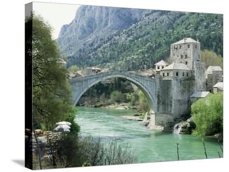 The Turkish Bridge Over the River Neretva Dividing the Town, Mostar, Bosnia, Bosnia-Herzegovina-Michael Short-Stretched Canvas Print