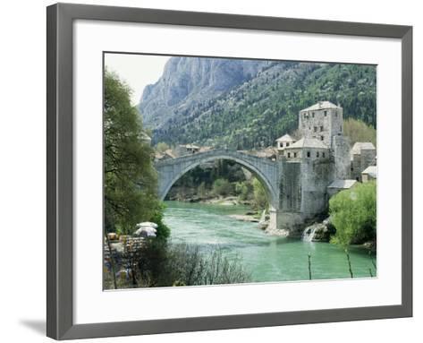 The Turkish Bridge Over the River Neretva Dividing the Town, Mostar, Bosnia, Bosnia-Herzegovina-Michael Short-Framed Art Print