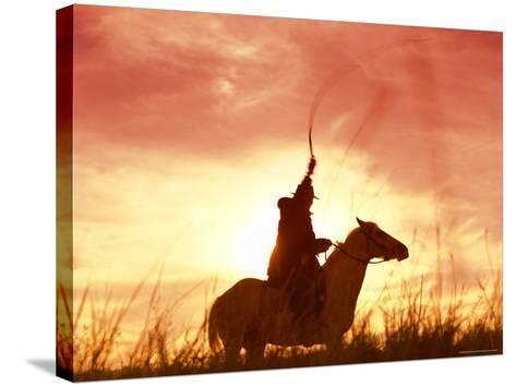 Profile of a Stockman on a Horse Against the Sunset, Queensland, Australia, Pacific-Mark Mawson-Stretched Canvas Print