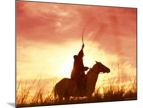Profile of a Stockman on a Horse Against the Sunset, Queensland, Australia, Pacific-Mark Mawson-Mounted Photographic Print
