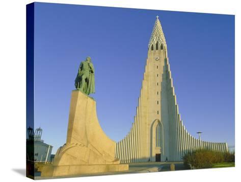 Statue of Liefur Eiriksson and the Hallgrimskikja Church, Reykjavik, Iceland, Polar Regions-Simon Harris-Stretched Canvas Print