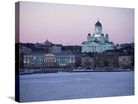 Dusk Light on Lutheran Christian Cathedral in Winter Snow, Across the Frozen Baltic Sea, Finland-Gavin Hellier-Stretched Canvas Print