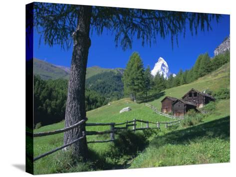The Matterhorn Towering Above Green Pastures and Wooden Huts, Swiss Alps, Switzerland-Ruth Tomlinson-Stretched Canvas Print