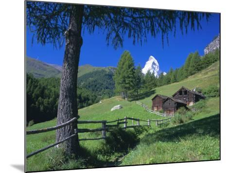 The Matterhorn Towering Above Green Pastures and Wooden Huts, Swiss Alps, Switzerland-Ruth Tomlinson-Mounted Photographic Print