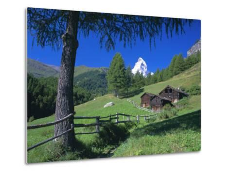 The Matterhorn Towering Above Green Pastures and Wooden Huts, Swiss Alps, Switzerland-Ruth Tomlinson-Metal Print