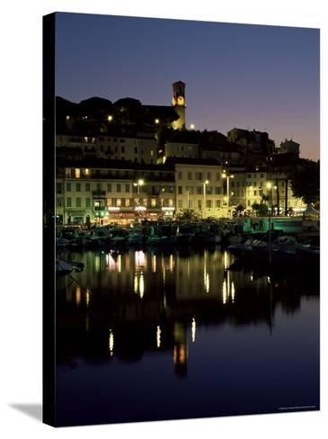 View Across Harbour to the Old Quarter of Le Suquet, at Night, Cannes, French Riviera, France-Ruth Tomlinson-Stretched Canvas Print