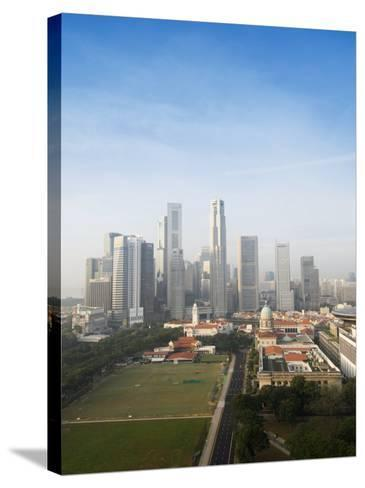 Singapore City Skyline at Dawn with the Padang and Colonial District in the Foreground, Singapore-Amanda Hall-Stretched Canvas Print